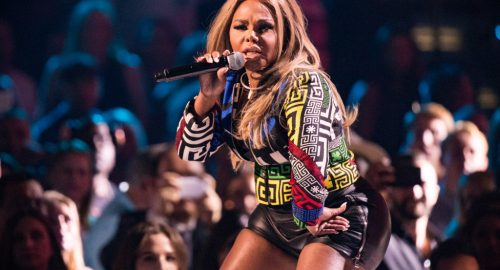 Recording artist Lil' Kim performs onstage at the 2015 iHeartRadio Music Festival at MGM Grand Garden Arena on September 19, 2015 in Las Vegas, Nevada. (Photo by Christopher Polk/Getty Images for iHeartMedia)